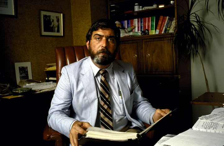 """Pollster Pat Caddell in his office speaking re: """"debategate"""" and holding Carter briefing book and materials from his 1980 cam"""