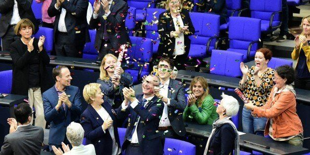 MP´s from the Green party celebrate with confetti following a debate and vote on same-sex marriage in...
