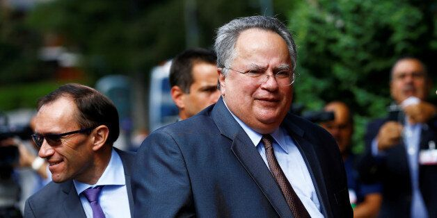 Greek Foreign Minister NikosKotzias arrives for peace talks on divided Cyprus under the supervision...