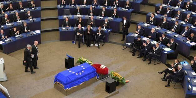 European Commission President Jean-Claude Juncker (L) is applauded by (front from C,L) former US President...