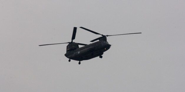 ATHENS, GREECE - 2015/03/25: A Chinook military helicopter flies above the crowd during the parade. The...