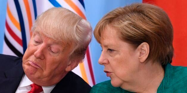 US President Donald Trump (L) and German Chancellor Angela Merkel attend a panel discussion on the second...