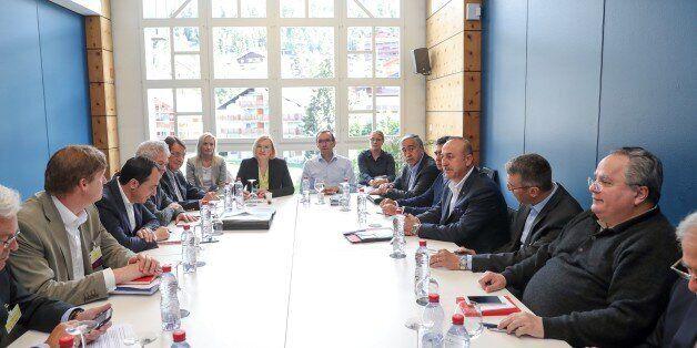 CRANS-MONTANA, SWITZERLAND - JULY 1: Foreign Affairs Minister of Turkey Mevlut Cavusoglu (3rd R), Turkish...