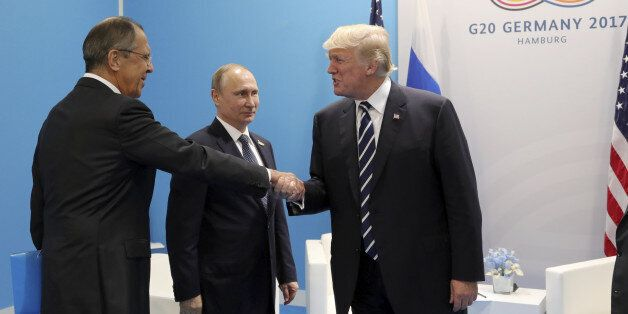 U.S. President Donald Trump (R) shakes hands with Russian Foreign Minister Sergei Lavrov as Russian President...