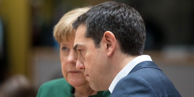 Alexis Tsipras, Greece's prime minister, right, and Angela Merkel, Germany's chancellor, speak ahead...