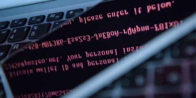 YEKATERINBURG, RUSSIA - JUNE 28, 2017: A reflection of a message demanding money on a computer hacked...