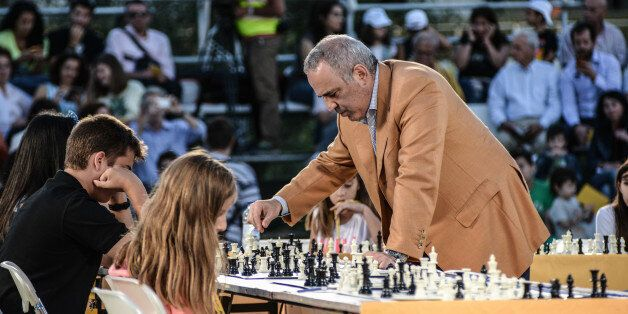 The chess chess grandmaster and former World Champion Garry Kasparov in a game against 15 young players...