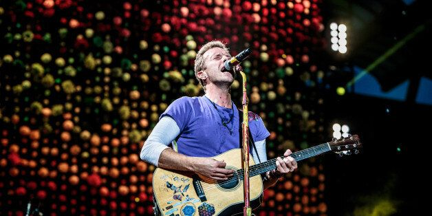 MILAN, ITALY - JULY 03: Chris Martin of British rock band Coldplay performs on stage at Stadio San Siro on July 3, 2017 in Milan, Italy. (Photo by Sergione Infuso/Corbis via Getty Images)