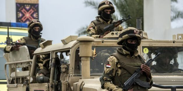 Members of the Egyptian army stand guard outside the venue of a conference for defence ministers and...