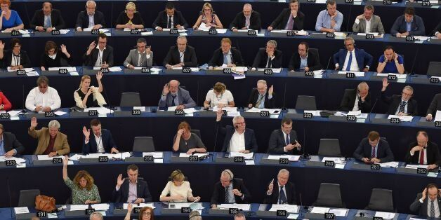 Members of the European Parliament take part in a voting session at the European Parliament in Strasbourg,...