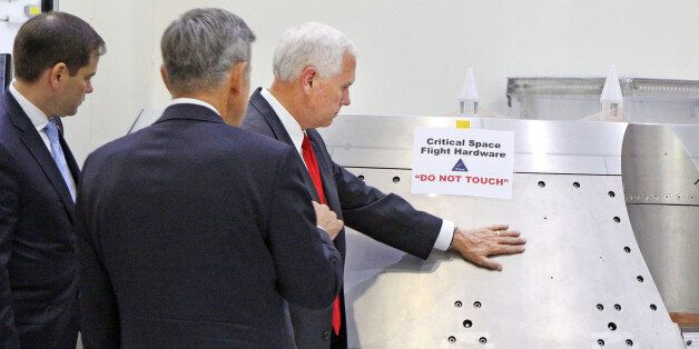 Vice President Mike Pence, right, gets a tour of the Orion clean room with Sen. Marco Rubio, left, by...