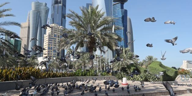 A general view taken on June 5, 2017 shows pigeons flying above the corniche in Doha. Arab nations including...