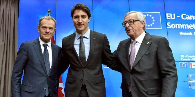 Canada's Prime Minister Justin Trudeau poses with European Council President Donald Tusk (L) and European...