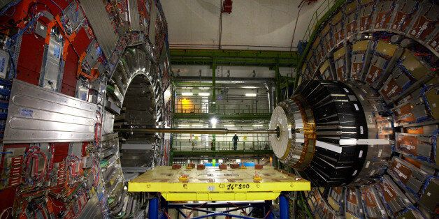 A technician stands near equipment of the Compact Muon Solenoid (CMS) experience at the Organization...