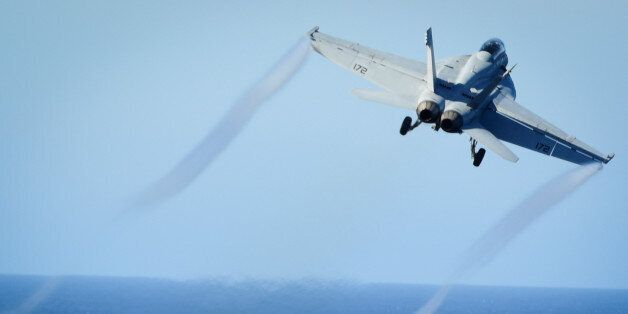 FILE PHOTO: An F/A-18E Super Hornet takes off from the flight deck of the U.S. Navy aircraft carrier...