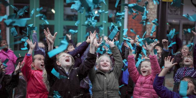 HULL, ENGLAND - JUNE 29: Young children catch paper helicopters falling from the sky as the world's most...
