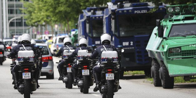 Austrian police officers ride on motorbikes ahead of the G20 summit in Hamburg, Germany, July 5, 2017....