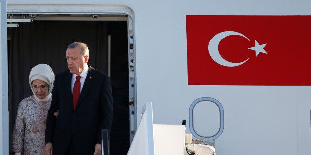 Turkey's President Recep Tayyip Erdogan and his wife Emine arrive for the G20 leaders summit in Hamburg,...
