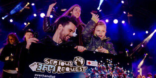 Dutch 3FM DJ's Domien Verschuuren (L) and Frank van der Lende show together with 6 year old Tijn Kolsteren...