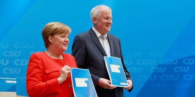 German Chancellor and head of the Christian Democrats party, Angela Merkel (L) and Horst Seehofer, leader...