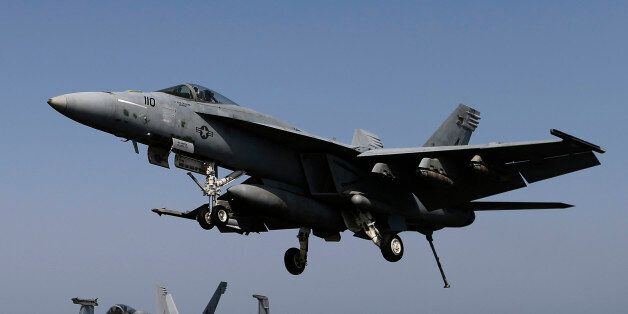 A F/A-18E Super Hornet of Strike Fighter Squadron (VFA-31) comes in to land onboard the flight deck of...