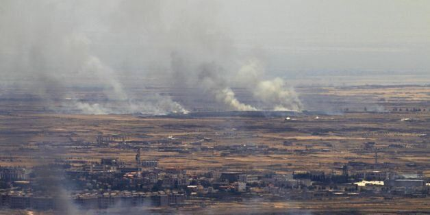 A picture taken from the Israeli-occupied Golan Heights shows smoke billowing from the Syrian side of...