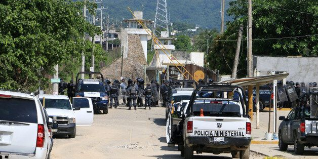 Riot police line up outside a prison after a riot broke out at the maximum security wing in Acapulco,...