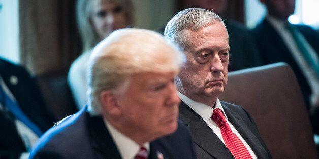 WASHINGTON, DC - JUNE 12: President Donald Trump and Defense Secretary Jim Mattis listen during a Cabinet...