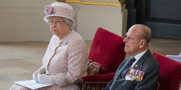 Britain's Queen Elizabeth and Prince Phillip attend a service to commemorate the 70th anniversary of...