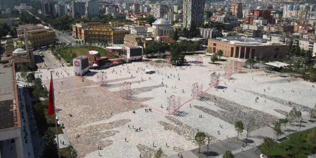 People walk on newly transformed Skenderbeg square in Tirana, Albania June 12, 2017. REUTERS/Florion