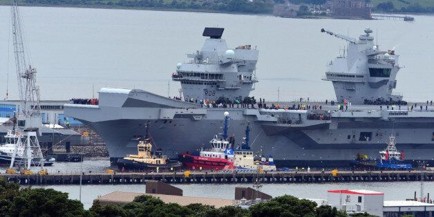ROSYTH, SCOTLAND - JUNE 26: The aircraft carrier HMS Queen Elizabeth leaves Rosyth dockyard to begin...