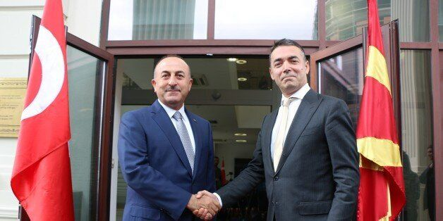 SKOPJE, MACEDONIA - JUNE 18 : Foreign Minister of Turkey Mevlut Cavusoglu (L) is welcomed by his Macedonian...
