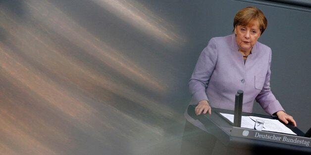 German Chancellor Angela Merkel addresses the lower house of parliament Bundestag in Berlin, Germany,...