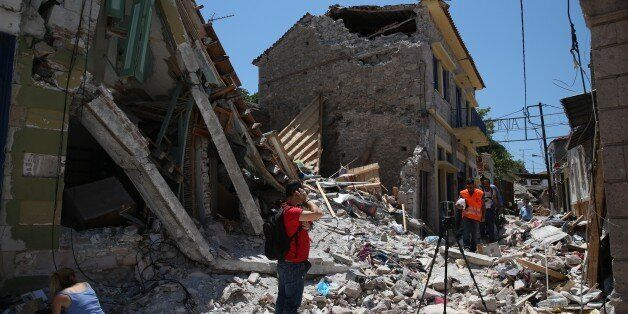 LESBOS, GREECE - JUNE 13 : Damaged buildings are seen after the 6,2 magnitude earthquake hit Vrisa village...