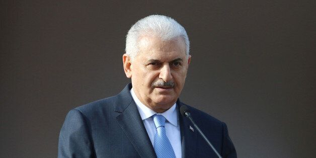 Turkish Prime Minister Binali Yildirim speaks to the media during a visit in Nicosia, northern Cyprus...