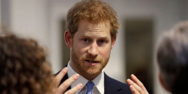 LONDON, UNITED KINGDOM - JUNE 15: Britain's Prince Harry speaks to people during his visit to Chatham...