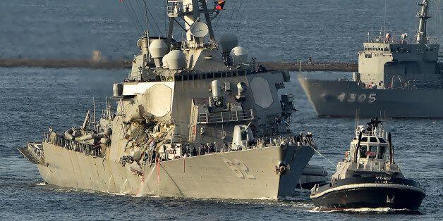 US Navy guided missile destroyer USS Fitzgerald arrves at its mother port US Naval Yokosuka Base, Kanagawa...