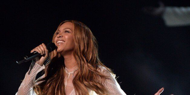 Beyoncé performs on stage at the 57th Annual Grammy Awards in Los Angeles February 8, 2015. AFP PHOTO...