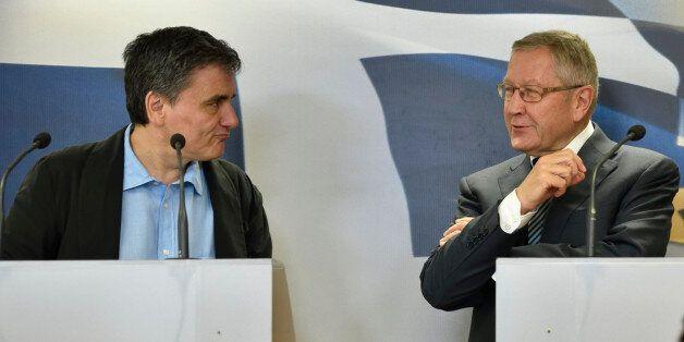 ATHENS, GREECE - JUNE 21: Greek Finance Minister Euclid Tsakalotos (L) and ESM Managing Director Klaus...
