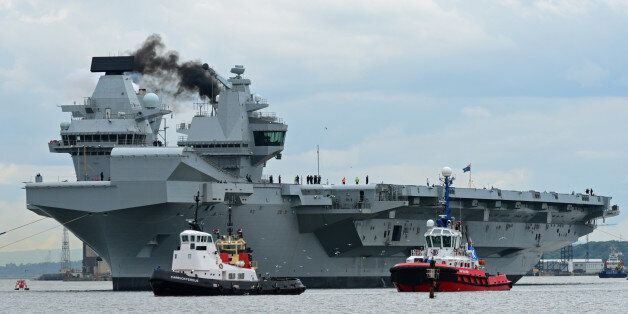 ROSYTH, SCOTLAND - JUNE 26: The aircraft carrier HMS Queen Elizabeth makes smoke as she leaves Rosyth...
