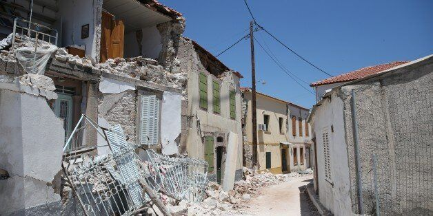 LESBOS, GREECE - JUNE 13 : Wreckages over the street are seen after the 6,2 magnitude earthquake hit...