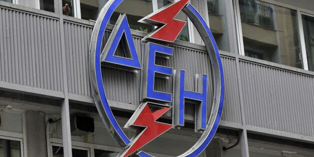 The logo of the Greek public electricity company DEI hangs on its building in Athens on April 28, 2011....