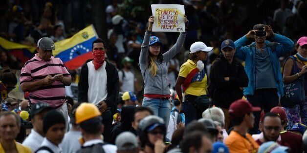 Opposition activists demonstrate against the government of Venezuelan President Nicolas Maduro in Caracas...