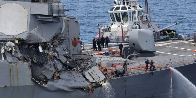 This picture shows damages on the guided missile destroyer USS Fitzgerald off the Shimoda coast after...