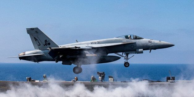MEDITERRANEAN SEA - JUNE 6: In this handout provided by the U.S. Navy, an F/A-18E Super Hornet attached...
