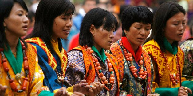 Bhutanese dancers take part in the annual Tsechu festival at Bhutanese district of Paro April 10, 2009....