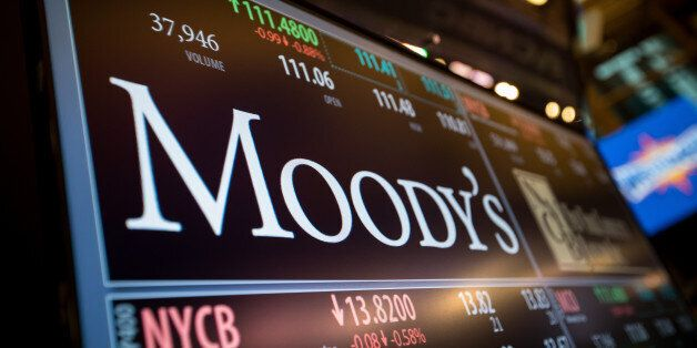A monitor displays Moody's Corp. signage on the floor of the New York Stock Exchange (NYSE) in New York,...