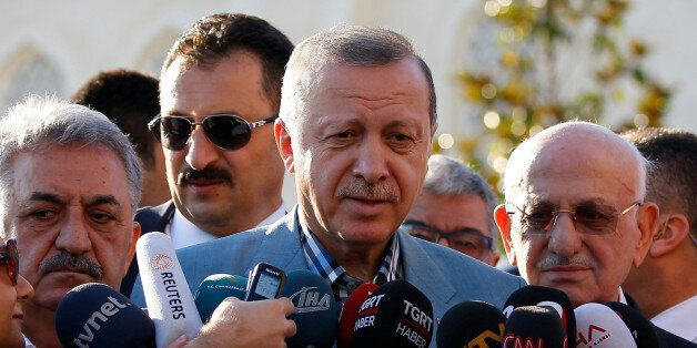 Turkey's President Tayyip Erdogan talks to media after the Eid al-Fitr prayers in Istanbul, Turkey, June...