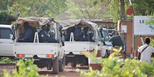 Malian anti-terrorist special forces 'Forsat' members enter the Kangaba tourist resort in Bamako on June...