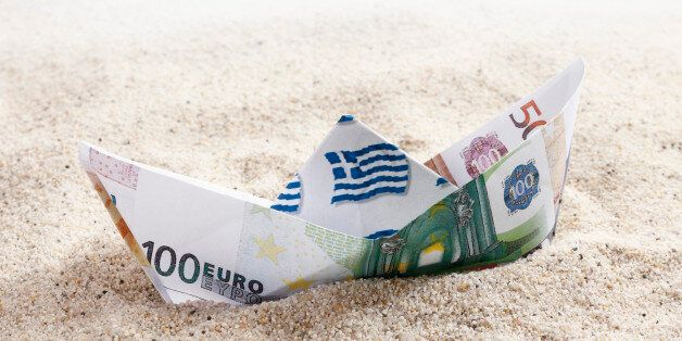 Origami paper boat of euro notes on